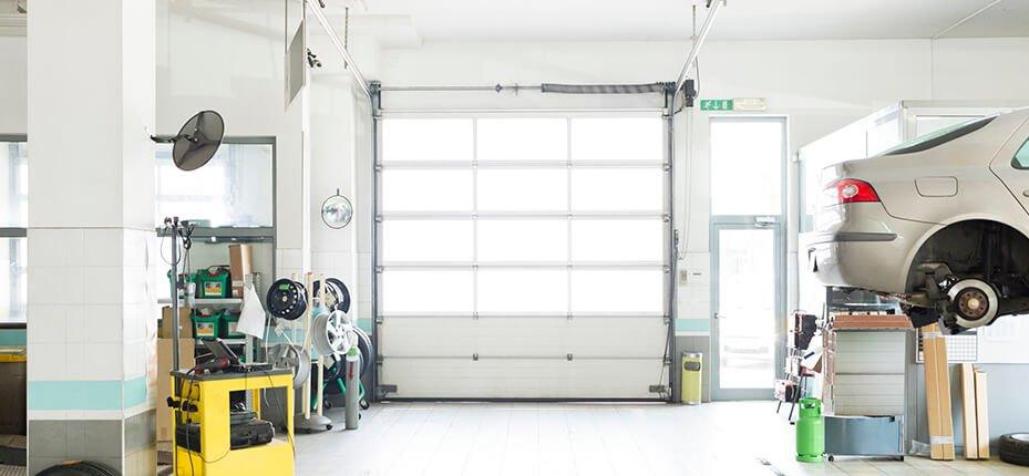white commercial garage door from interior of workshop
