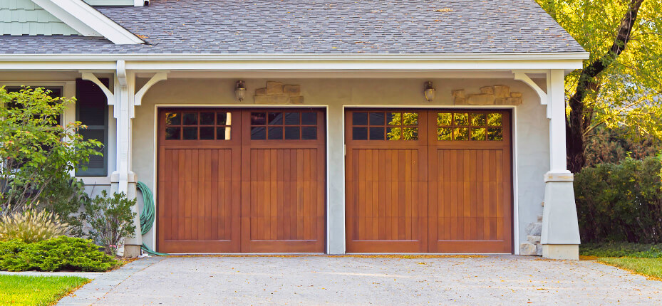 two car garage with wooden doors and small windows at top